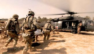 Soldiers rush a trauma victim to a U.S. Army medical helicopter in Tarmiyah, Iraq, Sept. 30, 2007. (U.S. Army)