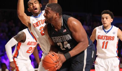Georgetown's Joshua Smith (24) drives to the basket against Florida's Jon Horfard (21) during their game in the Battle 4 Atlantis basketball tournament in Paradise Island, Bahamas, Wednesday Nov. 26, 2014. (AP Photo/Tim Aylen)