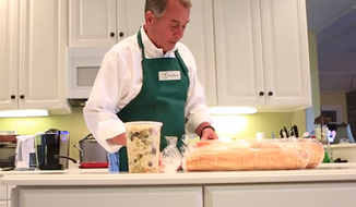 Speaker John Boehner dons a pair of blue jeans and a chef's apron in a new video he released ahead of Thanksgiving that explains how to properly brine a turkey, Boehner-style. (YouTube/John Boehner)