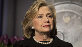 Hillary Rodham Clinton listens before delivering remarks at an event in New York in this Friday, Nov. 21, 2014, file photo. (AP Photo/Bebeto Matthews, File)