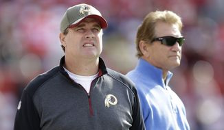 Washington Redskins head coach Jay Gruden, left, watches as players warm up next to former quarterback Joe Theismann before an NFL football game against the San Francisco 49ers in Santa Clara, Calif., Sunday, Nov. 23, 2014. (AP Photo/Ben Margot)