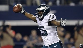 Philadelphia Eagles running back LeSean McCoy (25) celebrates as he enters the end zone for a touchdown against the Dallas Cowboys during the second half of an NFL football game, Thursday, Nov. 27, 2014, in Arlington, Texas. (AP Photo/Tim Sharp)