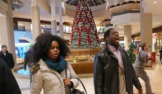 Protesters of the grand jury decision in the Michael Brown shooting march through the St. Louis Galleria mall Wednesday evening, Nov. 26, 2014, in Richmond Heights, Mo., chanting slogans. They stayed in the mall for about 15 minutes and then left peacefully without confrontation with a large police presence. (AP Photo/St. Louis Post-Dispatch, J.B. Forbes)