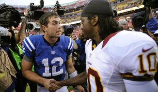 Indianapolis Colts quarterback Andrew Luck, left, greets Washington Redskins quarterback Robert Griffin III after an NFL preseason football game Saturday, Aug. 25, 2012, in Landover, Md. The Redskins won 30-17. (AP Photo/Nick Wass)