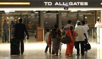 Passengers enter the gate area at Washington Dulles International Airport in Chantilly, Va., on Sept. 10, 2011. (Associated Press) **FILE**