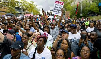 File - A large group yells out at a rally to protest the death of Eric Garner, Saturday, Aug. 23, 2014, in the Staten Island borough of New York. Amid the fallout from a grand jury's decision in the fatal police shooting of Michael Brown in Missouri, a panel in New York City is quietly nearing its own conclusion about another combustible case involving the death of an unarmed man at the hands of police. (AP Photo/Craig Ruttle, File)