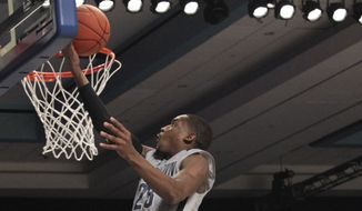 Georgetown's Aaron Bowen goes for a layup during their third place game against Butler in the Battle 4 Atlantis basketball tournament in Paradise Island, Bahamas, Friday, Nov. 28, 2014. (AP Photo/Tim Aylen)