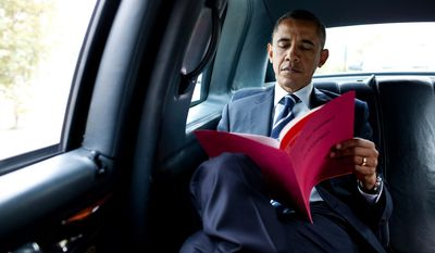 President Barack Obama reads a document while en route to Pittsburgh International Airport in Pittsburgh, Pa., Oct. 11, 2011. (Official White House Photo by Pete Souza)
