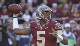 Florida State quarterback Jameis Winston (5) throws a pass during the first half of an NCAA college football game against Florida in Tallahassee, Fla., Saturday, Nov. 29, 2014. (AP Photo/John Raoux)