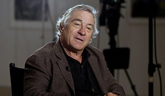 Actor Robert De Niro is interviewed by Chris Wallace at the DC Moore Gallery, in New York in this June 11, 2014, file photo. (AP Photo/Richard Drew, File)
