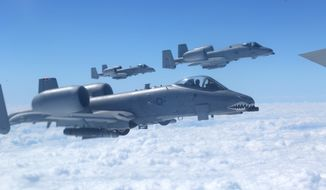"""Air power: """"Nothing reassures and protects friendly forces and scatters and destroys enemy forces like an A-10,"""" a target spotters association tells Defense Secretary Chuck Hagel. (Associated Press)"""