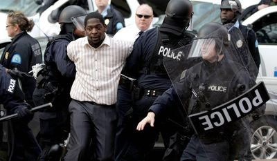 Protest organizer Derrick Robinson is arrested during clashes with police outside a St. Louis Rams football game Sunday. (associated press)
