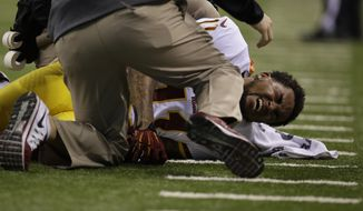 Washington Redskins wide receiver DeSean Jackson is injured during the second half of an NFL football game against the Indianapolis Colts Sunday, Nov. 30, 2014, in Indianapolis. (AP Photo/AJ Mast)