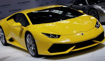 A Lamborghini Huracan LP 610-4 is displayed during the annual press conference of the Volkswagen AG in Berlin, Germany, Thursday, March 13, 2014. (AP Photo/Michael Sohn)