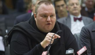 Internet entrepreneur Kim Dotcom speaks during the Intelligence and Security select committee hearing at Parliament in Wellington, New Zealand, July 3, 2013. (Associated Press)