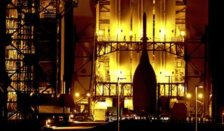 In this Nov. 12, 2014 file photo, after a 22-mile journey from the Launch Abort System Facility at the Kennedy Space Center, the Orion Spacecraft arrives at Space Launch Complex 37B at the Cape Canaveral Air Force Station, in Cape Canaveral, Fla. The test flight for Orion is scheduled to launch on Dec. 4. (Associated Press)