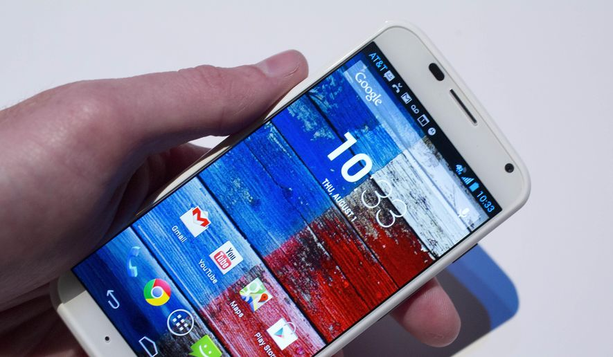 In this Thursday, Aug. 1, 2013, file photo, the Motorola Moto X smartphone, using Google's Android software, is shown at a media preview in New York. (AP Photo/Mark Lennihan, File)