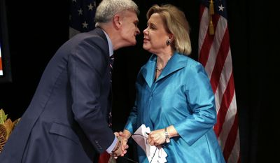 Sen. Mary Landrieu, D-La., greets Senate candidate, Rep. Bill Cassidy, R-La., before their debate at Centenary College in Shreveport, La., Tuesday, Oct. 14, 2014. (AP Photo/Gerald Herbert)