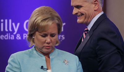 Sen. Mary Landrieu, D-La., and Rep. Bill Cassidy, R-La., take their places to participate in a Senate race debate with and Republican candidate and Tea Party favorite Rob Maness, not pictured,  on the LSU campus in Baton Rouge, La., Wednesday, Oct. 29, 2014. (AP Photo/Gerald Herbert)