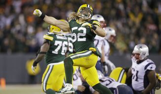 Green Bay Packers' Clay Matthews celebrates after the New England Patriots missed a field goal attempt during the second half of an NFL football game Sunday, Nov. 30, 2014, in Green Bay, Wis. (AP Photo/Tom Lynn)