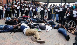 This photo provided by Jackson State University Communications shows students participating in a nationwide Hands Up Walkout on the main campus, Monday, Dec. 1, 2014, in Jackson, Miss. Students protested the no-true bill handed down by a Ferguson, Mo., grand jury in the shooting death of Michael Brown, an unarmed 18 year old teen, by Ferguson Police Officer Darren Wilson.  (AP Photo/Jackson State University Communications, Charles A. Smith)
