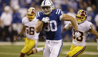 Indianapolis Colts tight end Coby Fleener heads for a touchdown during the second half of an NFL football game against the Washington Redskins Sunday, Nov. 30, 2014, in Indianapolis. (AP Photo/Darron Cummings)