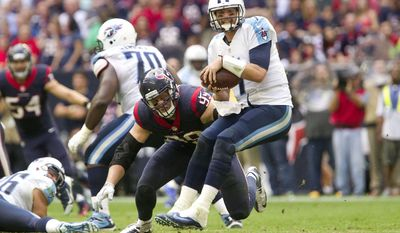 Houston Texans defensive end J.J. Watt (99) sacks Tennessee Titans quarterback Zach Mettenberger during an NFL football game Sunday, Nov. 30, 2014, in Houston. (AP Photo/Conroe Courier, Jason Fochtman)