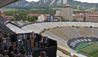 The campus and foothills are seen in the background during a news conference at the University of Colorado's football stadium in Boulder, Colorado. (Associated Press)