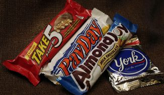 Hershey's candy bars Take 5, PayDay, Almond Joy and a York Peppermint Patty, examples of products that use corn syrup, are displayed for a photo in New York on Dec. 2, 2014. (Associated Press) **FILE**