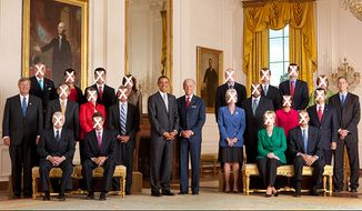 President Barack Obama and Vice President Joe Biden pose with the full Cabinet for an official group photo in the East Room of the White House on Sept. 10, 2009.