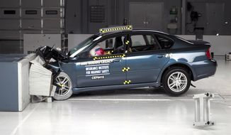 This undated photo provided by the Insurance Institute for Highway Safety shows the frontal offset crash test of the 2005 Subaru Legacy. Documents posted Tuesday, Dec. 2, 2014 by U.S. safety regulators say Subaru is expanding a previous recall of five models, including the 2005 Legacy, to fix potentially faulty passenger air bags in high-humidity states. (AP Photo/Insurance Institute for Highway Safety)