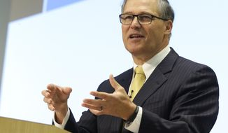 Washington Gov. Jay Inslee speaks Tuesday, Dec. 2, 2014, at the Washington STEM (science, technology, engineering, and math education) Summit on the Microsoft campus in Redmond, Wash. (AP Photo/Ted S. Warren)