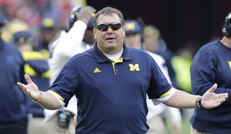 Michigan head coach Brady Hoke on the sidelines against Ohio State during an NCAA college football game Saturday, Nov. 29, 2014, in Columbus, Ohio. (AP Photo/Jay LaPrete)