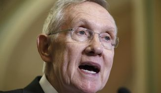 Senate Majority Leader Harry Reid of Nev. speaks with reporters following a closed-door policy meeting on Capitol Hill in Washington, Tuesday, Dec. 2, 2014.  (AP Photo/J. Scott Applewhite)