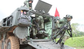 The Singapore Armed Forces conduct military exercises. (Photo courtesy of Singapore Ministry of Defense)