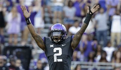 FILE - In this Oct. 25, 2014, file photo, TCU quarterback Trevone Boykin (2) celebrates a score against Texas Tech in the second half of an NCAA college football game in Fort Worth, Texas. (AP Photo/Tony Gutierrez, File)