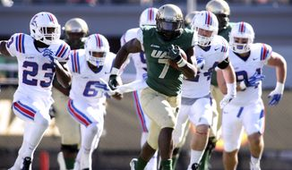 FILE - In this Nov. 8, 2014, file photo, UAB running back Jordan Howard is chased by Louisiana Tech defenders during an NCAA college football game in Birmingham, Ala.(AP Photo/AL.com, Hal Yeager, File)