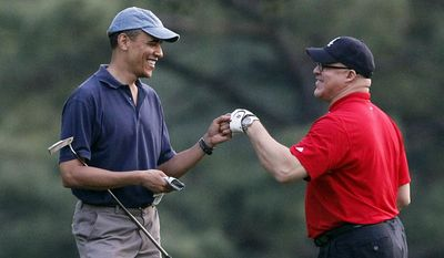 "FILE - In this April 23, 2014, file photo, President Barack Obama, left, fist bumps with Dr. Eric Whitaker on a golf course at Grove Park Inn in Asheville, N.C. Federal prosecutors are putting pressure on Whitaker, the former Illinois public health director, and friend of President Obama, to cooperate in an ongoing investigation of a state grant scandal. Whitaker is not accused of any wrongdoing, but prosecutors declared him a ""hostile"" witness in the case, rejecting his claims to be fully cooperating with a probe into others, including a former employee. (AP Photo/Alex Brandon, File)"