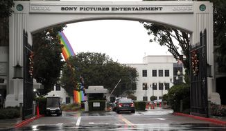 FILE - In this Dec. 2, 2014 file photo, cars enter Sony Pictures Entertainment headquarters in Culver City, Calif. Sony Pictures said the investigation into the cyberattack that crippled its computer systems is continuing and denies a report that it is poised to name North Korea as the culprit. (AP Photo/Nick Ut, File)