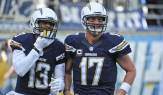 San Diego Chargers quarterback Philip Rivers, right, and wide receiver Keenan Allen jog off the field together after the pair combined on a 43 yard touchdown pass against the New York Giants during the first half of an NFL football game Sunday, Dec. 8, 2013, in San Diego. (AP Photo/Denis Poroy)