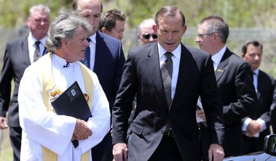 Australia's Prime Minister Tony Abbott , right, walks with father Michael Alcock before the funeral of Australian cricketer Phil Hughes in Macksville, Australia, Wednesday, Dec. 3, 2014. (AP Photo/Rob Griffith) ** FILE **