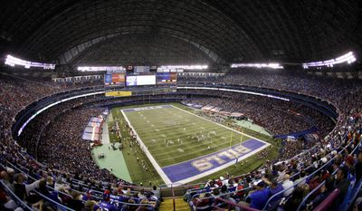 """FILE - In this Oct. 30, 2011, file photo, the Washington Redskins and the Buffalo Bills play an NFL football game at the Rogers Centre in Toronto. The Buffalo Bills are done playing regular season """"home"""" games in Toronto after reaching an agreement with Canadian-based communications giant Rogers Communications to terminate the four remaining years left on the series. Bills president Russ Brandon announced the decision Wednesday, Dec. 3, 2014, in what was not regarded as a surprise. (AP Photo/Derek Gee, File)"""