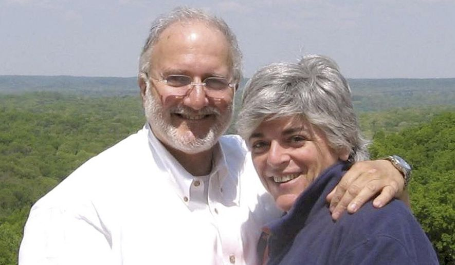 This file handout photo provided by the Gross family shows Alan and Judy Gross in an unknown location. (AP Photo/Gross Family, File)