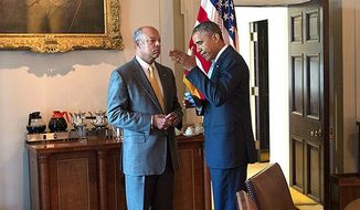 President Barack Obama talks with Homeland Security Secretary Jeh Johnson in the Cabinet Room of the White House, July 25, 2014. (Official White House Photo by Pete Souza)