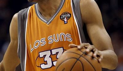 "In May 2010, the Phoenix Suns wore ""Los Suns"" jerseys during Game 2 of their NBA second-round playoff basketball series, a move owner Robert Sarver said was ""to honor our Latino community and the diversity of our league, the state of Arizona, and our nation"" after Arizona passed restrictive laws targeting illegal immigrants. (AP Photo/Ross D. Franklin, File)"