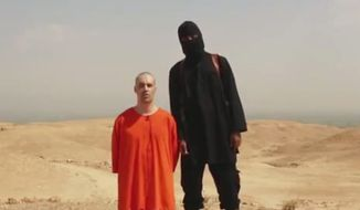 "This undated image shows a frame from a video released by Islamic State militants on Tuesday, Aug. 19, 2014, that shows the killing of journalist James Foley by the militant ""Jihadi John."" Foley, from Rochester, N.H., went missing in 2012 in northern Syria while on assignment for Agence France-Press and the Boston-based media company GlobalPost. (AP Photo/File)"