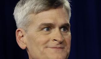 FILE - In this Dec. 1, 2014 file photo, Louisiana Republican Senate candidate, Rep. Bill Cassidy, R-La., waits for the start of the final debate against Mary Landrieu for the Senate election runoff in Baton Rouge, La.  In 2002, a public hospital physician named Bill Cassidy donated to Democratic Sen. Landrieu's first re-election campaign. A year later, he used a newspaper letter to the editor to lambast Republican gubernatorial candidate Bobby Jindal as a disaster for Louisiana's health care system. Those days are past for Cassidy, now a Republican congressman who is favored to defeat Landrieu and win election to the Senate in this weekend's runoff election.  (AP Photo/Gerald Herbert, File)