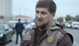 Chechen regional leader Ramzan Kadyrov talks with press in the Chechen regional capital, Grozny, Russia, in this Oct. 5, 2014 photo. A gun battle broke out after midnight Thursday  Dec. 4, 2014 in the capital of Russia's North Caucasus republic of Chechnya, puncturing the patina of stability ensured by years of heavy-handed rule by Chechen leader Ramzan Kadyrov.  (AP Photo/Musa Sadulayev, File)