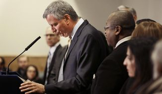 New York City Mayor Bill de Blasio, surrounded by community leaders, speaks to reporters about the grand jury's decision in the Eric Garner case in the borough of Staten Island in New York, Wednesday, Dec. 3, 2014. A grand jury cleared the white New York City police officer Wednesday in the videotaped chokehold death of Garner, an unarmed black man, who had been stopped on suspicion of selling loose, untaxed cigarettes, a lawyer for the victim's family said.  A video shot by an onlooker and widely viewed on the Internet showed the 43-year-old Garner telling a group of police officers to leave him alone as they tried to arrest him. The city medical examiner ruled Garner's death a homicide and found that a chokehold contributed to it.  (AP Photo/Seth Wenig)