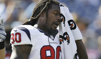 Houston Texans linebacker Jadeveon Clowney warms up before an NFL football game against the Tennessee Titans Sunday, Oct. 26, 2014, in Nashville, Tenn. (AP Photo/Wade Payne)